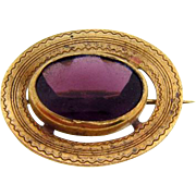 Late 1800's circular gold filled Brooch with large center Amethyst glass stone