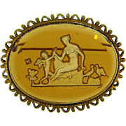 Vintage amber glass Intaglio Brooch with Grecian scene