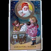 SOLD GEL German Christmas Postcard—Smiling Santa Watches Girls at Play