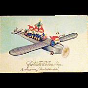 EAS German Christmas Fantasy Postcard w Adorable Gnomes Flying Airplane