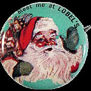 Celluloid 'Meet Me at LOBEL'S' Santa Pinback Button