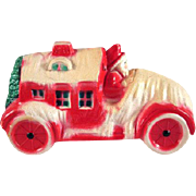 Viscoloid Santa in a Truck with a House and Christmas Tree Celluloid Toy