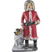 Cast Lead Santa with Toys and Bag Christmas Figure