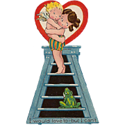 Made In Germany Girl Holding Cupid on a Ladder Away From a Frog Valentine