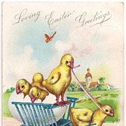 Vintage Tuck Loving Easter Greetings Chicks Pull and are in a Cart Postcard 1907