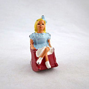SOLD Barclay Young Girl in a Rocking Chair Toy Lead Figure