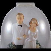 SALE Hard Plastic Bride & Groom in Bell Cake Topper