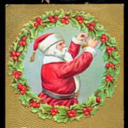 Santa Claus in Gilt with Wreath 1910 Postcard