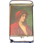 Celluloid wrapped match safe, image attractive lady, by Whitehead & Hoag, cigar cutter, ...