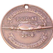 "Douglas DC-4 ""First Around the World.."" Rare Numbered Fob / Medallion"