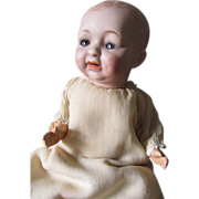 Antique Bisque Porcelain Character Baby Doll Blue Eyes