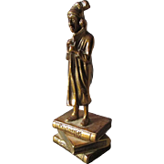 Bronze Sculpture of a Charles Dickens Character Man Standing on Books