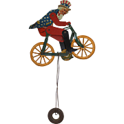 SOLD A.C. Gilbert Uncle Sam Lithographed String Balance Tin Toy, circa 1920
