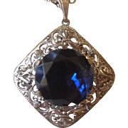 Art Deco Filigree Silvertone Pendant Necklace with Large Navy Glass Stone.