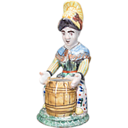 French Faience of Nevers, Woman sitting a barrel