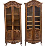 A similar pair of Louis XV Style Vitrine or display cabinet