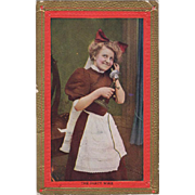 Old Postcard - Photograph of Maid on the Telephone Party Wire
