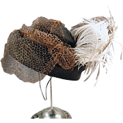 Striking Old Hat with Net Veil and Feather Plume