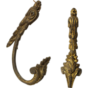 Pair of French bronze tiebacks