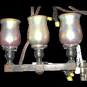 Pair of original three light iron Arts & Crafts Steuben replica sconces