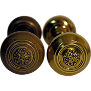Original early 1900's brass door knobs with simple floral design
