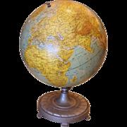 Vintage 1950's globe with cast iron base.