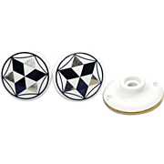 Black and gold porcelain knob set with switch plate