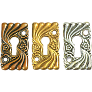 Set of Art Nouveau wavy floral key hole covers