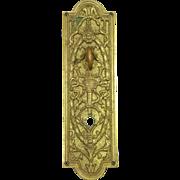 Highly ornate brass door plate