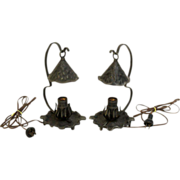 Pair of unusual small Arts and Crafts iron lamps