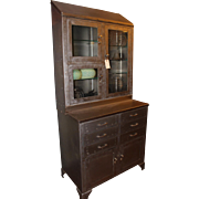 Steel hutch with multiple drawers and shelves
