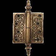 Ornate bronze hinge with steeple tips