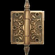 Single bronze ornate steeple tip hinge