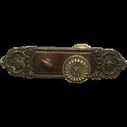 Ornate Greek knob set with plates
