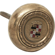 Brass knob with Cadillac emblem