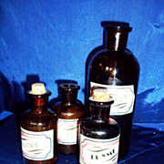 Four Brown  Vintage Medicine Bottles