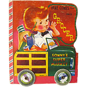Cut Out Childrens Book Here Comes The Grocer With Rolling Wheels Cover / Vintage Illustrated C