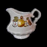 Vernonware Fruit Basket by Metlox  cream pitcher        circa 1970