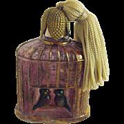 Antique bird cage bottle
