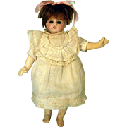 SOLD Small bisque head girl on French body