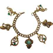 Hssssss!  Antique Gold-tone Charm Bracelet with Snakes and Dragons