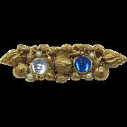 1928 Jewelry Company Seashell and Blue Rhinestone Brooch