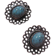 Pretty Silver Tone and Turquoise Colored Pierced Earrings