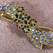 Nolan Miller Green, Red and Clear Rhinestones Bow Pin