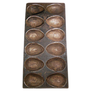 SALE PENDING Old Metal Twelve Large Egg Shaped Chocolate Mold