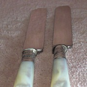 Pair of Sterling and Mother of Pearl Dinner Knives