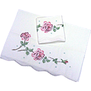 Pair of Pillowcases with Embroidered Burgundy and Pink Floral Design
