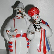 REDUCED Russian Kiev Experimental Ceramic Factory Peasant Man & Woman Carrying Pig  Figurine .