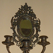 Quasi pair of French brass sconces with beveled mirror