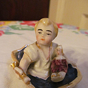 Baby Boy Figure on Lid with Doll and Horn